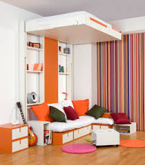 Down Bed And White Wall Shelves Also L Shaped Sectional Sofa Colorful Cushions Plus Small Coffee Table Apartment Decorating Ideas