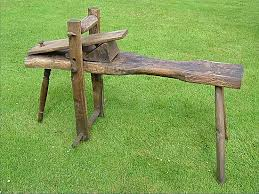 shave horse in solid oak with turned front leg in ash excellent
