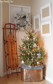 Christmas Entryway With Copper Boiler Tree Stand Vintage Sled And Framed Sheet
