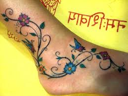 Colored Flowers And Butterfly Tattoo On Ankle