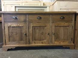 A Rustic Plank Sideboard With Slightly Different Cut Out Feet And Antique Brass Cup Handles