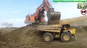 100 Dump Trucks Videos Hitachi EX5500 Excavator Loading CAT 789 Truck Open Pit Mining