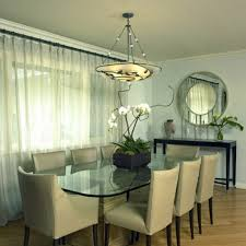 Simple Flower Arrangements For Modern Dining Room With Large Glass Table And Round Wall Mirror Also Using White Curtains Ideas