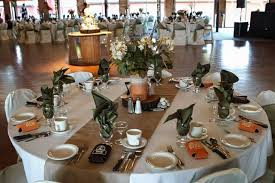Rustic Burlap Wedding Decorations With Small Flowers In Vase On Round Table And White