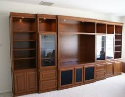 Custom Built In Wall Unit With Lighting And Glass Doors