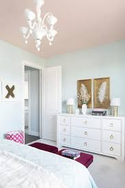 A Pink Ceiling Beautifully Complements Light Blue Walls In This Stylish Girls Bedroom Decorated With White