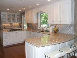 fair grey color subway tile kitchen backsplash with white wooden