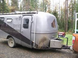 REDONE ON INSIDE WITH WAY MORE STORAGE THAN IT WAS MADE INTSLD 3 BURNER STOVE W OVEN THREE FRIDGE AND FACTORY BATHROOM IVE OWNED THIS CAMPER FOR