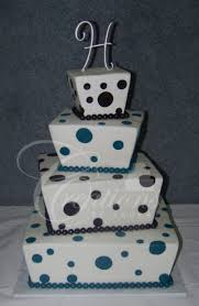 white off set angled square wedding cake blue and black polka dots