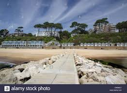 100 Canford Cliffs Beach Huts And Sands Poole UK Stock Photo
