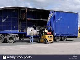A Forklift Truck Loads Unloads A Double Deck Curtainsided Trailer ... Classroom Valentines Truck Loads Wild Ink Press Oversize Load Strikes Damages Bridge Overpass Full Taa Logistics Welcome To Freight Innovations Domestic Holiday Savings At Junkman Vegasjunkman The Top 4 Mistakes In Transporting Oversized Truck Loads Forrest Serious Modern Logo Design For Local Produce Australia By Jems Petsmart Announces The First Of Nearly 90 Semitruck Deliveries Driving Jobs Search Or Trucks North Shore And Transportation Driver On Lift Products Plant Longford Precast Removal Guy Fniture Removalshousehold Removssmall Office