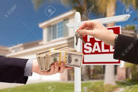 Agent Handing Over Keys As Buyer Is Cash For House With Home And