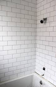 the white subway tile on the wall so clean and fresh best 25