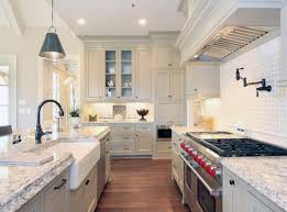 Country Style Galley Kitchen With White Cabinets Farmhouse Sink And Subzero Wolf Range