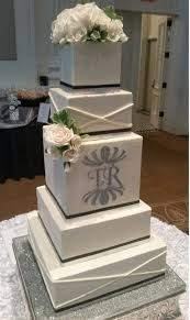 Square monogram wedding cake white black silver