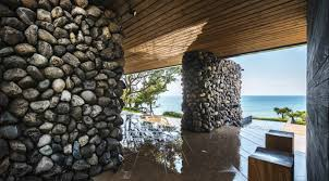 100 Flintstone House Dick Clark Atolan Is A Seafront Home Built With Rocks Excavated During