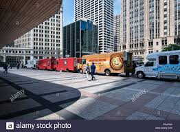 Food Trucks On Michigan Avenue, Downtown Chicago, IL Stock Photo ... Naanse Chicago Food Trucks Roaming Hunger Ice Cubed Food Truck Pinterest May Start Docking At Ohare And Midway Airports Eater Smokin Chokin And Chowing With The King Truck Foods Ruling To Cide Mobile Foods Fate In Guide Trucks Locations Twitter Police Exploit Social Media Crack Down On Delicious Best In Cbs A Visual Representation Of History Now Sushi Roadblock Drink News Reader