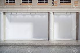 Front View Of Window Display With Empty Storefront And Columns Advertising Boutique Retail Concept