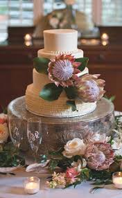 Cant Get Enough Of This Chic White Wedding Cake Adorned With Protea Flowers