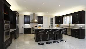 Spacious Modern Kitchen With Dark Cabinetry Breakfast Bar 4 Diner Style Stools And