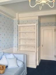 new york light blue wallpaper nursery traditional with baby crib