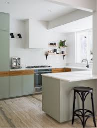 Sage Green Kitchen White Cabinets by A Clean And Fresh Looking Kitchen Remodel With Sage Kitchen
