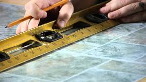 how to install self adhesive floor tiles on top of tiles
