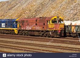 100 Trucks With Tracks Railway Tracks With Locomotive And Goods Trucks Stock Photo