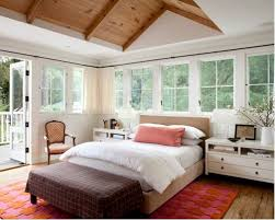 Example Of A Country Master Medium Tone Wood Floor Bedroom Design In Other With White Walls