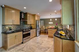 fancy kitchen floor ideas with light cabinets using tumbled marble