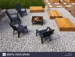 Red Patio Furniture Canada by Paving Stone Patio With Adirondack Chairs Red Cedar Wooden Bench