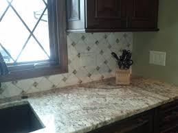 pinwheel tile backsplash shows a backsplash installed
