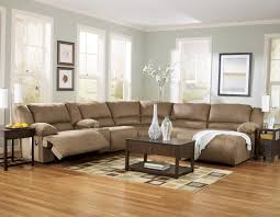curvy grey fabric sofa with dark brown wooden table with drawer on
