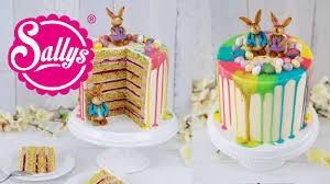 drip cake ostertorte mit bunten regenbogenfarben und schokol