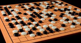 A Traditional Game Of Go Takes Place On Wooden Board With 19x19 Grid
