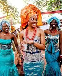 igba nkwu day igbo bride carrying wine to groom