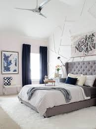 Modern Glam Bedroom With Gray Tufted Headboard