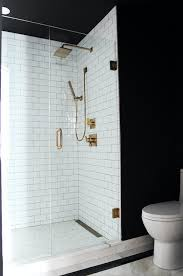 black and white bathroom with subway tiled shower transitional