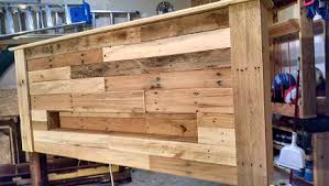 Pallet Wood Headboard with Coach Lights and a Recessed Shelf How