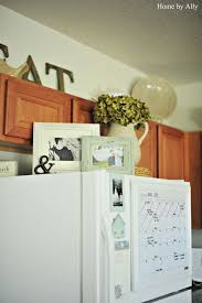 Cute Picture Frames On Top Of Fridge Doing This