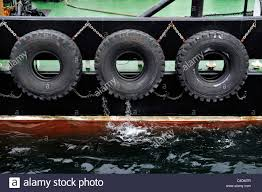 100 Truck Fenders Close Up Of Truck Tyres Used As Fenders On The Side Of A Tugboat In