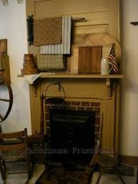 Primitive Decorating Ideas For Fireplace by Gas Fireplace With Colonial Mantle Style Decorated For A Primitive