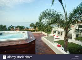100 Tree Houses With Hot Tubs Palm Tree Beside Raised Deck With Hot Tub In Grounds Of