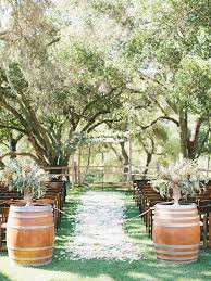 Rustic Wedding Ceremony Aisle Decor With Wooden Barrels