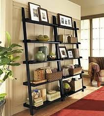 bookshelves with ladder contemporary painting family room for
