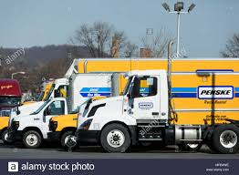 100 Penski Truck A Logo Sign And Rental Trucks Outside Of A Facility Occupied By