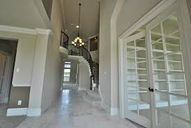 High Ceiling Foyer Lighting With Stairs Under Recessed Lights Glass Door