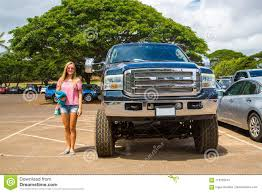 Huge Ford Monster Truck In Comparison To A Young Lady Stock Image ... Comparison Test 2016 Chevrolet Colorado Vs Gmc Canyon Diesel Truck Tool Compare 2017 Ford F150 Toyota Truck Comparison Blog Post List Mike Bass Midsize Best Pickup Trucks Toprated For 2018 Edmunds Ram 1500 Silverado Big Three Chevy New Small Used Trucks Check More At Http Hilux Versus Ranger Review Salary Full Size Huge Monster In To A Young Lady Stock Image