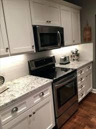kitchen cabinets lincoln ne on the walls white granite