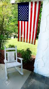 American Flag Overhanging On Porch With Child's Wicker Rocking.. Lovely Wood Rocking Chair On Front Porch Stock Photo Image Pretty Redhead Country Girl Nor Vector Exterior Background Veranda Facade Empty Archive By Category Farmhouse Hometeriordesigninfo For And Kids Room Ideas 30 Gorgeous Inviting Style Decorating New Outdoor Fniture Navy Idea Landscape Country Porch Porches Decks And Verandas Relax Traditional Southern Style Front With Rocking Vertical Color Image Of Chairs Sitting On A White Rockers The